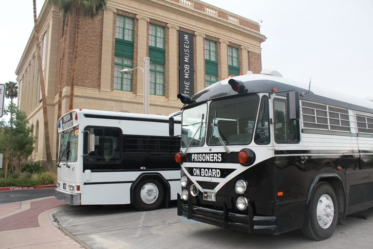 Two prison buses parked outside the Mob Museum in Las Vegas Nevada