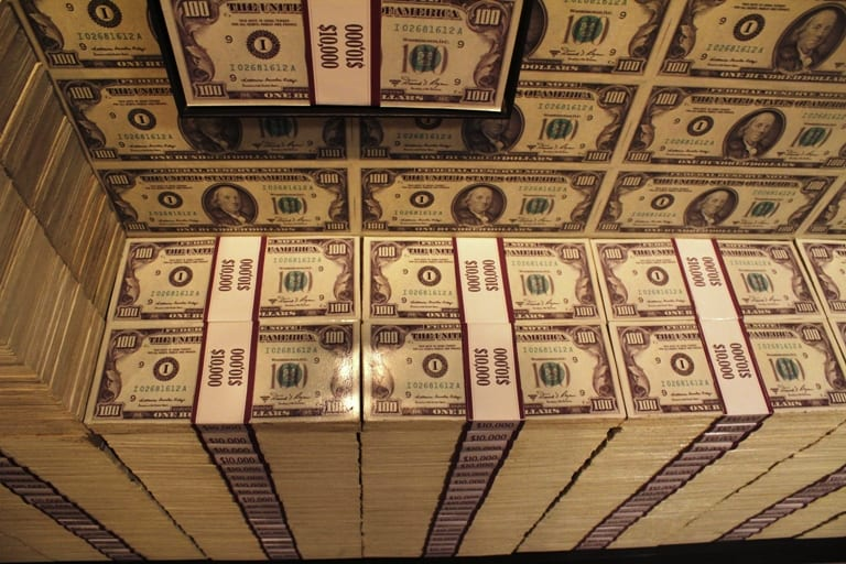 A wall of fake money at the Mob Museum