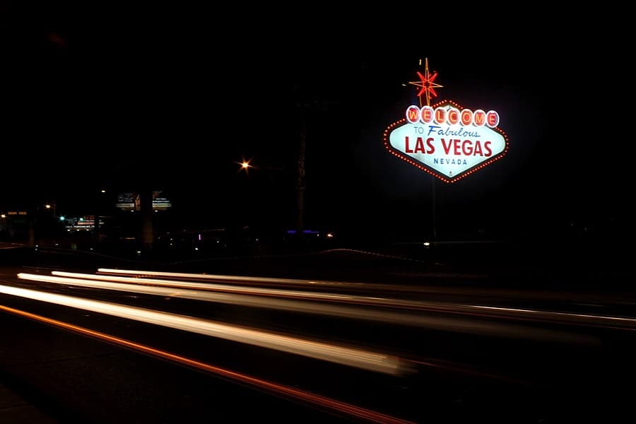 Another picture of Welcome to Fabulous Las Vegas sign at night with blurred motion from cars