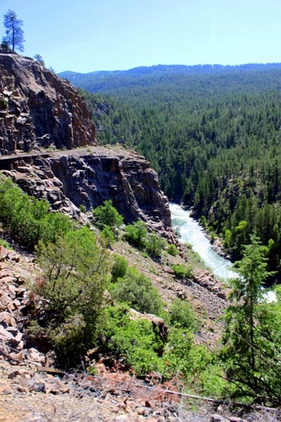 View of a 400-foot drop from the cliffs to the Animas River during the Durango to Silverton train ride