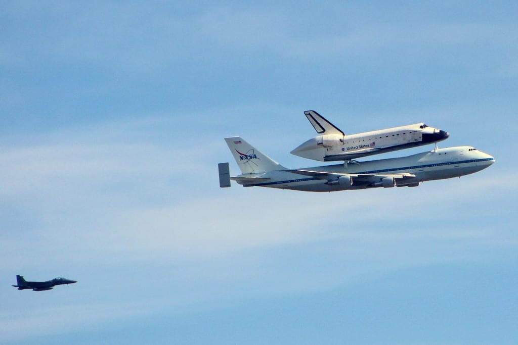The retired NASA space shuttle Endeavour flies over Palo Alto