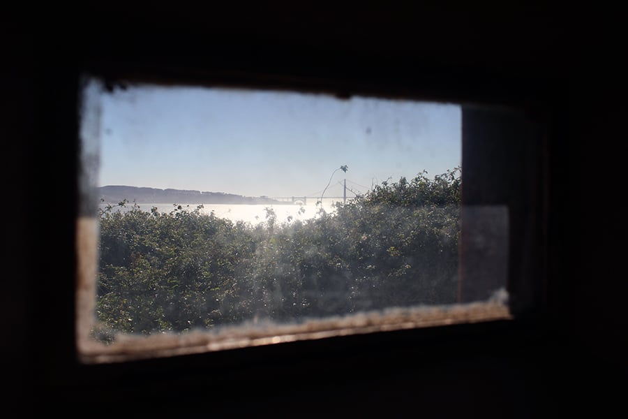 The view of San Francisco Bay from a tiny window in the prison. You can see the Golden Gate Bridge in the distance.