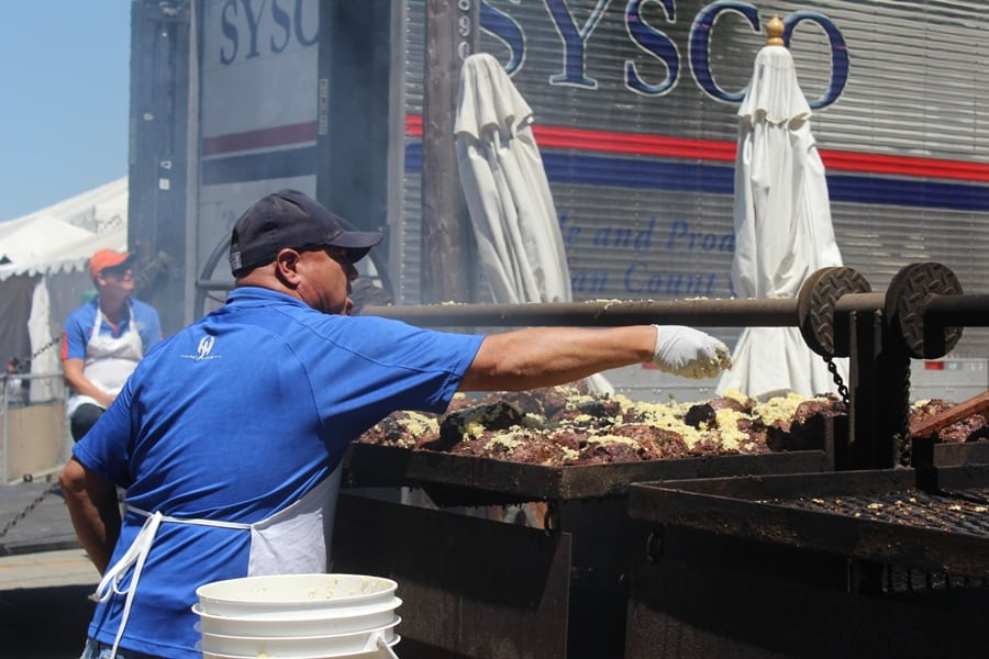 This guy was sprinkling garlic chunks over 6 pounds of garlic. He said on Friday alone he would cook up 2,000 pounds of meat for festival-goers.