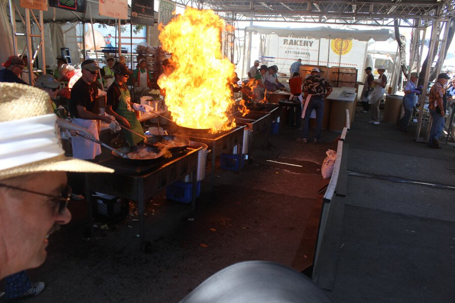"They call these ""flame-ups"" for obvious reasons. It was bizarre...it's a cooking show where the cooks sing along and dance to rock music while trying to see how big they can get the ""flame-ups"" to be."