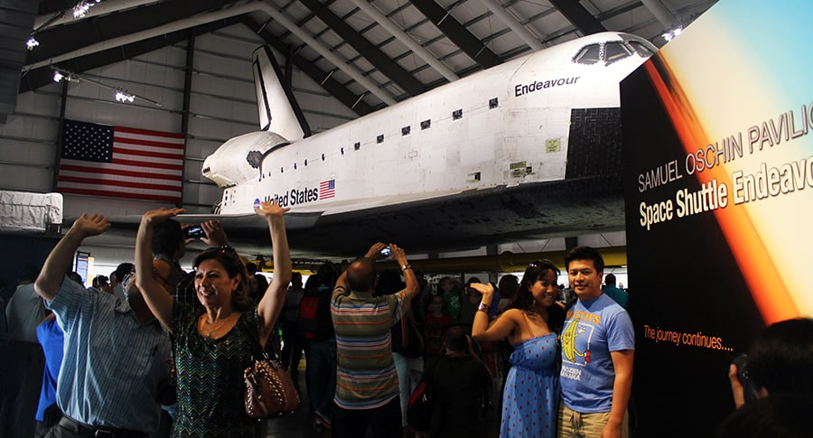People posing in front of Endeavour