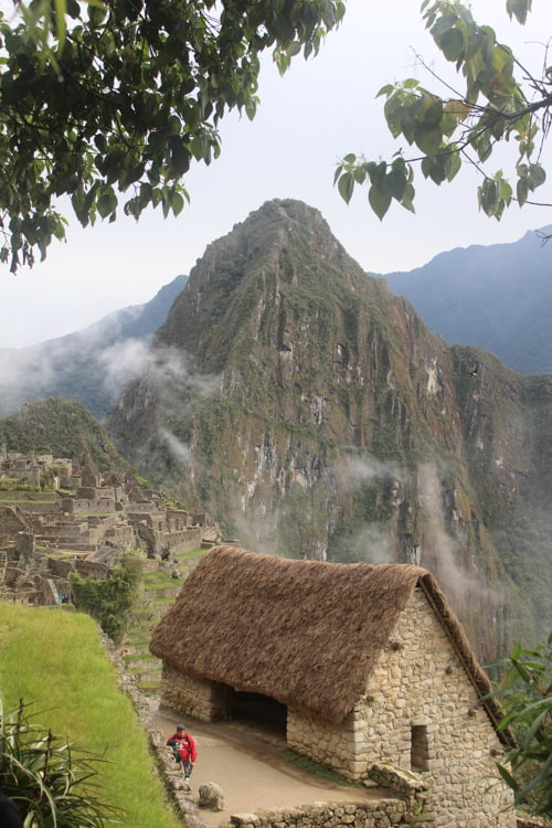 The Gatekeepers Hut and Huayna Picchu framed by leaves