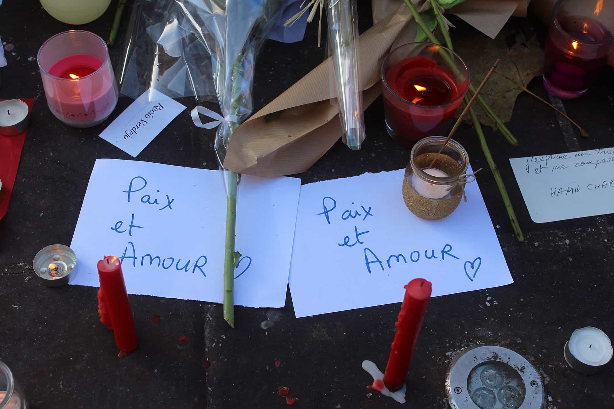"""Peace and Love"" written on signs at the Place de la Republique in Paris following the Paris terror attacks"