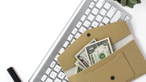 freelancer financial mistakes - money and keyboard