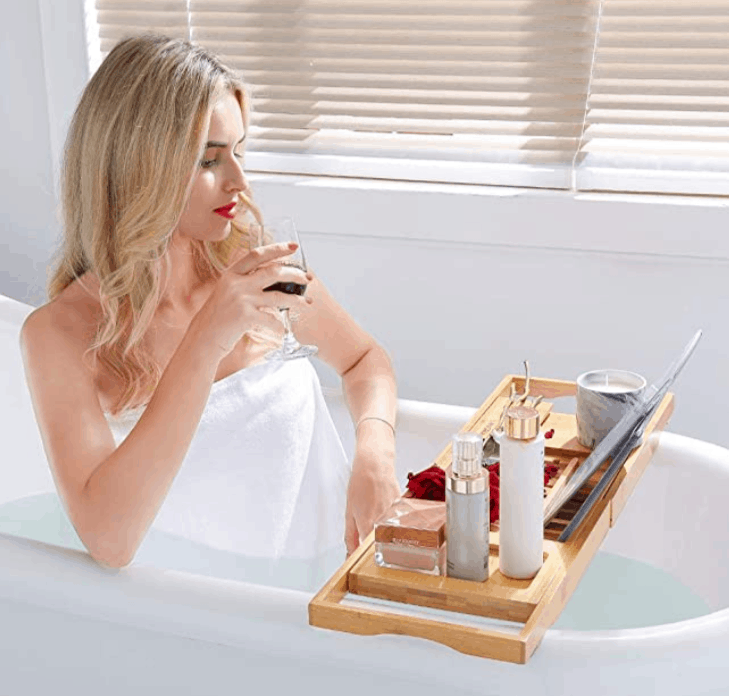 Woman sipping wine in bath tub