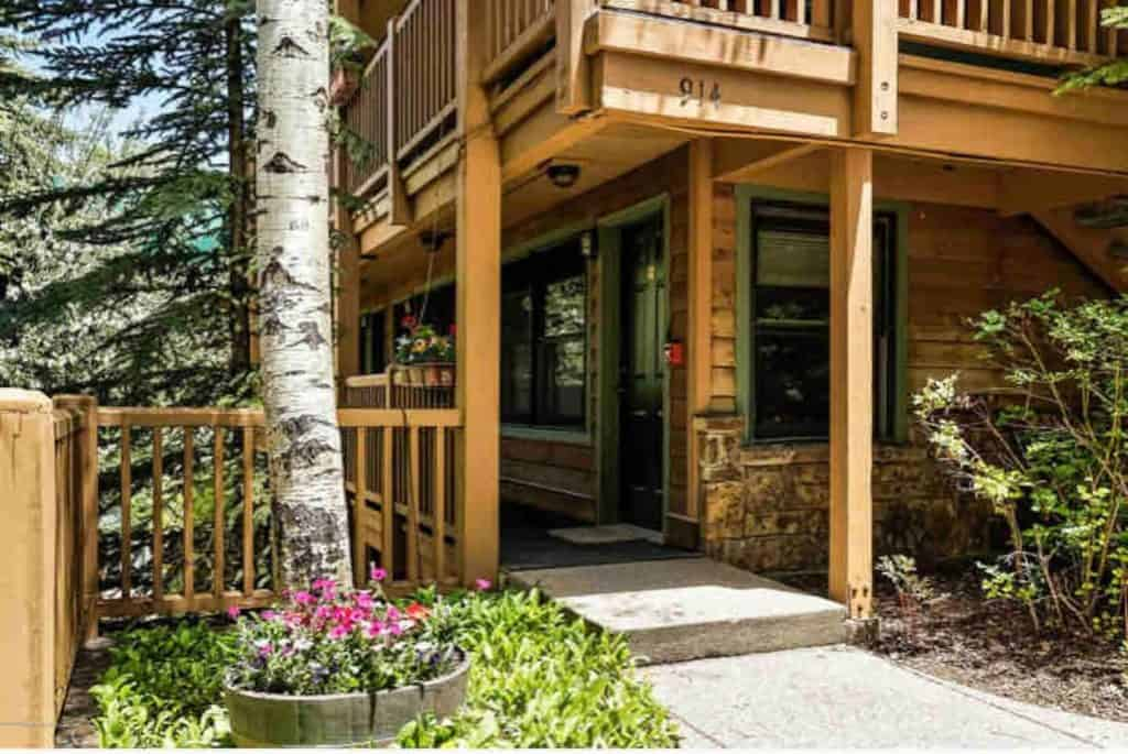the exterior of a rustic airbnb outside of downtown aspen