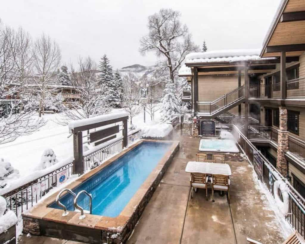 luxury condo airbnb in aspen colorado overlooking the pool and hott ub